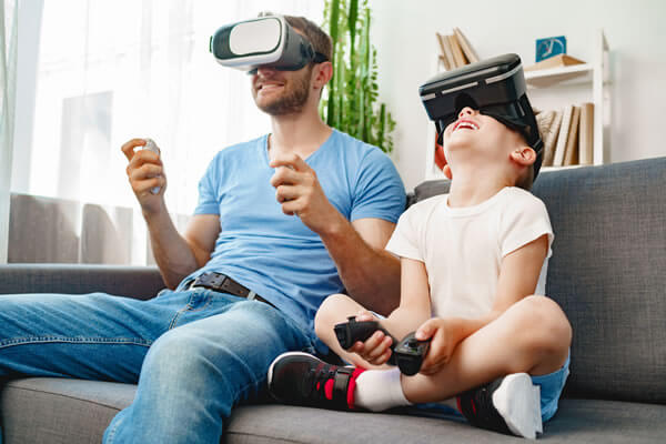 dad-son--playing-games-with-vr-glasses-together