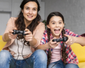 mother daughter playing-video-games-together