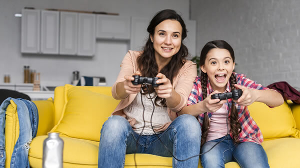Mother daughter playing video games